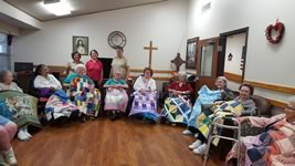 Residents of the Shady Oaks Nursing Home in Moulton are pictured with lap quilts donated by the Shiner Heritage Quilters Guild.  Guild members who presented the quilts are pictured standing in the back (l to r) Betty Maskey, Carolyn Whitmire and Bernadette Kresta.  To date, the Guild has donated 90 quilts to area nursing homes.Residents of the Shady Oaks Nursing Home in Moulton are pictured with lap quilts donated by the Shiner Heritage Quilters Guild.  Guild members who presented the quilts are pictured standing in the back (l to r) Betty Maskey, Carolyn Whitmire and Bernadette Kresta.  To date, the Guild has donated 90 quilts to area nursing homes.